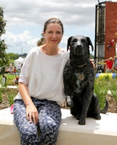 Brisbane sculptor Kathy McLay poses with her lifesize bronze statue of Sarbi, the former Australian Special Forces explosives detection dog at the opening of Sarbi Park at Warner Lakes. Photo: Michelle Smith